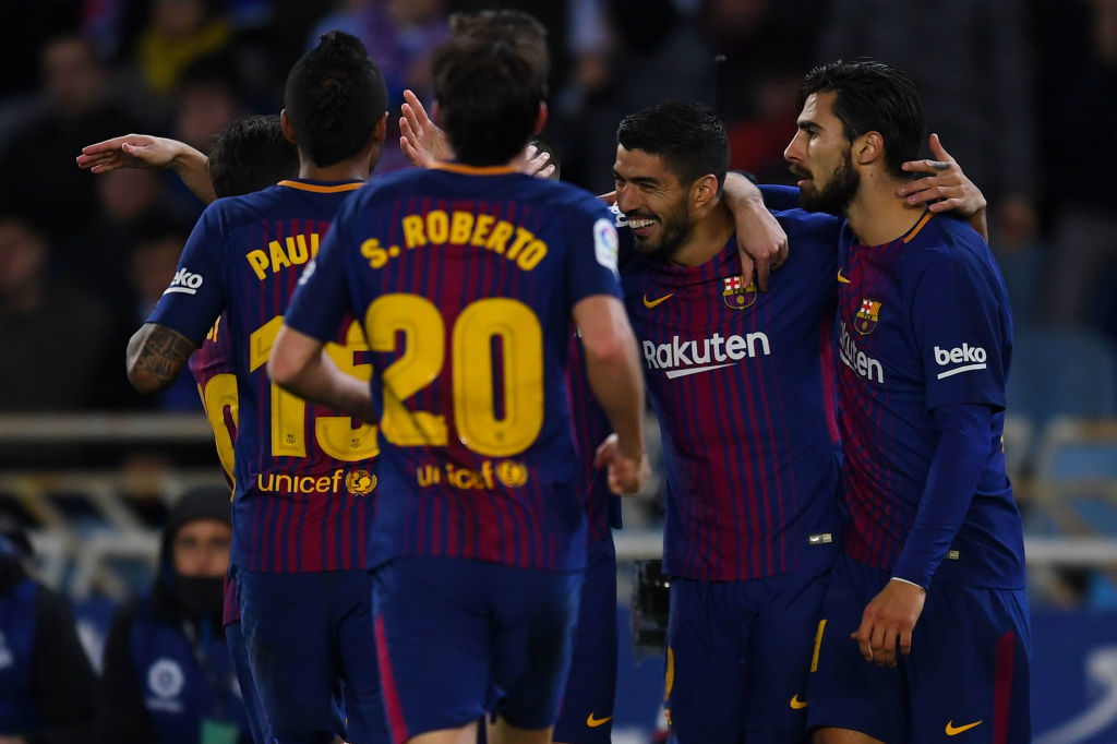 SAN SEBASTIAN, SPAIN - JANUARY 14: Luis Suarez of FC Barcelona (2ndR) celebrates with team  mates after scoring his team's second goal during the La Liga match between Real Sociedad and FC Barcelona at Anoeta stadium on January 14, 2018 in San Sebastian, Spain.  (Photo by David Ramos/Getty Images)