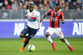 NICE, FRANCE - NOVEMBER 26: (L-R) Tanguy Ndombele Alvaro of Olympique Lyon, Jean Michael Seri of Nice during the French League 1  match between Nice v Olympique Lyon at the Allianz Riviera on November 26, 2017 in Nice France (Photo by Eric Verhoeven/Soccrates/Getty Images)