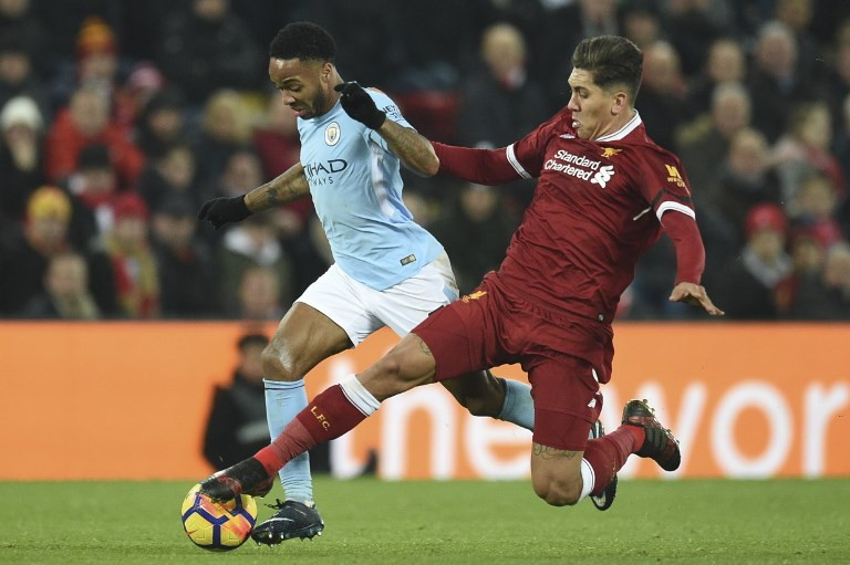 Liverpool's Brazilian midfielder Roberto Firmino (R) chases back to try to tackle Manchester City's English midfielder Raheem Sterling (L) during the English Premier League football match between Liverpool and Manchester City at Anfield in Liverpool, north west England on January 14, 2018. / AFP PHOTO / Oli SCARFF / RESTRICTED TO EDITORIAL USE. No use with unauthorized audio, video, data, fixture lists, club/league logos or 'live' services. Online in-match use limited to 75 images, no video emulation. No use in betting, games or single club/league/player publications.  /