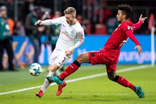 Leverkusen's German defender Benjamin Henrichs (R) vies with Bremen's Austrian midfielder Florian Kainz  during the German first division Bundesliga football match between Bayer Leverkusen and SV Werder Bremen on December 13, 2017 in Leverkusen. / AFP PHOTO / DPA / Marius Becker / Germany OUT / RESTRICTIONS: DURING MATCH TIME: DFL RULES TO LIMIT THE ONLINE USAGE TO 15 PICTURES PER MATCH AND FORBID IMAGE SEQUENCES TO SIMULATE VIDEO. == RESTRICTED TO EDITORIAL USE == FOR FURTHER QUERIES PLEASE CONTACT DFL DIRECTLY AT + 49 69 650050