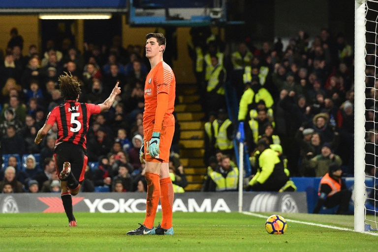 Bournemouth's Dutch defender Nathan Ake (L) celebrates scoring the team's third goal past Chelsea's Belgian goalkeeper Thibaut Courtois during the English Premier League football match between Chelsea and Bournemouth at Stamford Bridge in London on January 31, 2018. / AFP PHOTO / Glyn KIRK / RESTRICTED TO EDITORIAL USE. No use with unauthorized audio, video, data, fixture lists, club/league logos or 'live' services. Online in-match use limited to 75 images, no video emulation. No use in betting, games or single club/league/player publications.  /