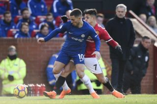 Manchester United's Chilean striker Alexis Sanchez (R) challenges Chelsea's Belgian midfielder Eden Hazard (L) during the English Premier League football match between Manchester United and Chelsea at Old Trafford in Manchester, north west England, on February 25, 2018. / AFP PHOTO / Oli SCARFF / RESTRICTED TO EDITORIAL USE. No use with unauthorized audio, video, data, fixture lists, club/league logos or 'live' services. Online in-match use limited to 75 images, no video emulation. No use in betting, games or single club/league/player publications.  /