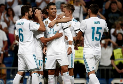 MADRID, SPAIN - AUGUST 23: Cristiano Ronaldo (C) of Real Madrid celebrates with his teammates after scoring a goal during a Santiago Bernabeu Cup soccer match between Real Madrid and Fiorentina at Santiago Bernabeu in Madrid, Spain on August 23, 2017. Burak Akbulut / Anadolu Agency