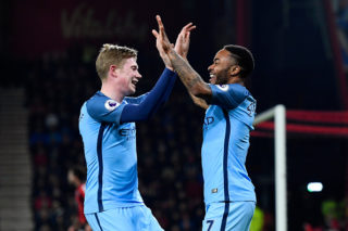 BOURNEMOUTH, ENGLAND - FEBRUARY 13:  Raheem Sterling of Manchester City celebrates with Kevin De Bruyne after scoring the opening goal during the Premier League match between AFC Bournemouth and Manchester City at Vitality Stadium on February 13, 2017 in Bournemouth, England.  (Photo by Stu Forster/Getty Images)