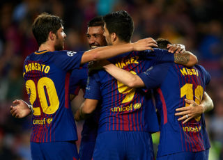 BARCELONA, SPAIN - OCTOBER 18:  Lionel Messi of Barcelona celebrates scoring his team's second goal with his teammates Luis Suarez, Sergi Roberto and Paulinho during the UEFA Champions League group D match between FC Barcelona and Olympiakos Piraeus at Camp Nou on October 18, 2017 in Barcelona, Spain.  (Photo by Manuel Queimadelos Alonso/Getty Images)
