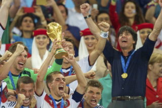 (L-R) Lukas Podolski of Germany, Philipp Lahm of Germany, Thomas Muller of Germany, coach Joachim Low of Germany with world cup trophy during the final of the FIFA World Cup 2014 on July 13, 2014 at the Maracana stadium in Rio de Janeiro, Brazil.(Photo by VI Images via Getty Images)