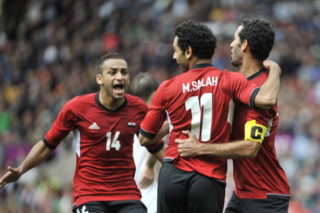 MANCHESTER, UNITED KINGDOM - JULY 29:  Mohamed Salah of Egypt celebrates scoring his goal with team mates during the Men's Football first round Group C Match between Egypt and New Zealand on Day 2 of the London 2012 Olympic Games at Old Trafford on July 29, 2012 in Manchester, England. (Photo by Francis Bompard/Getty Images)