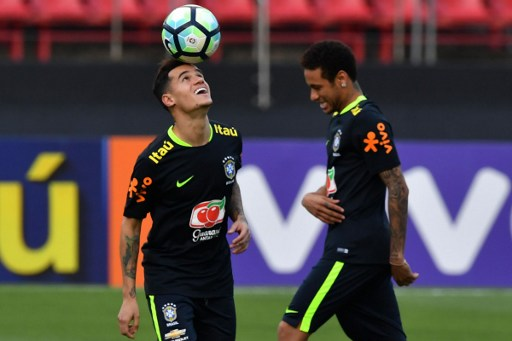 Brazil's team players Philippe Coutinho (L) and Neymar (R) take part in a training session at the Morumbi stadium in Sao Paulo, Brazil on March 25, 2017 ahead of a 2018 FIFA Russia World Cup qualifier match against Paraguay on March 28 in Sao Paulo, Brazil.