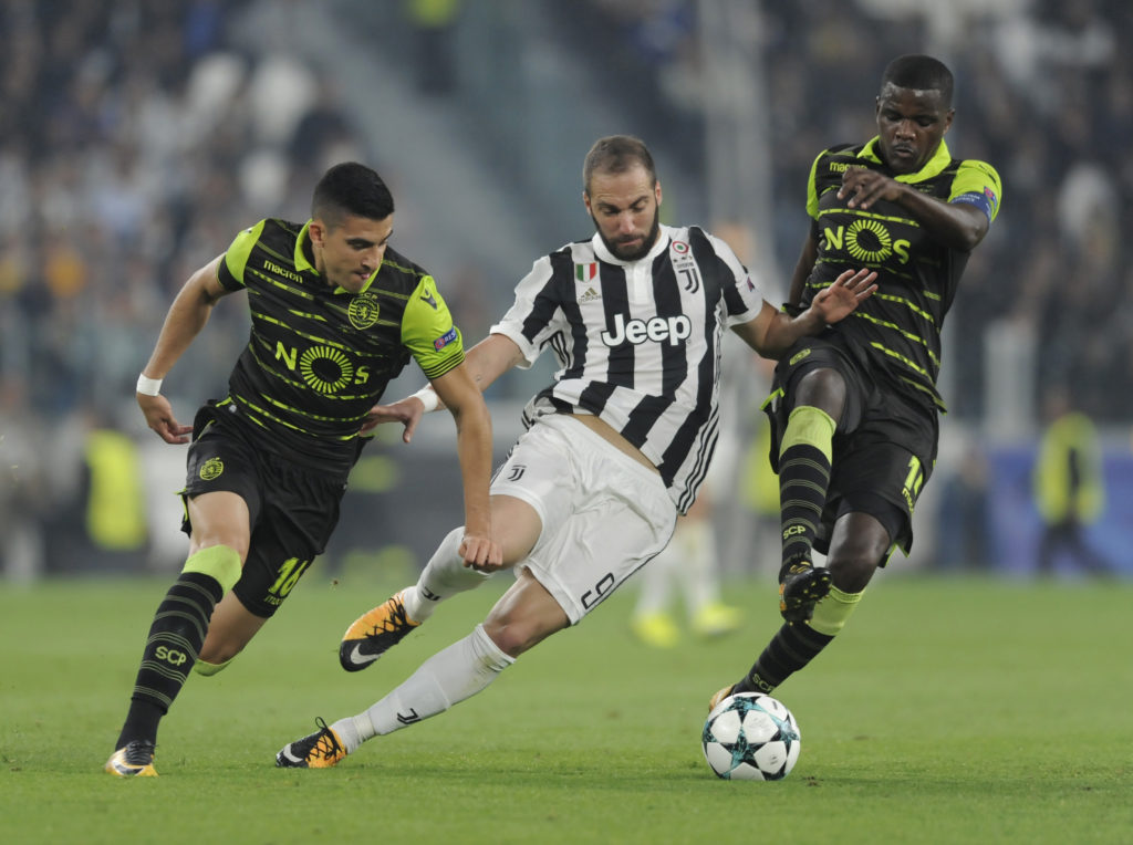 Gonzalo Higuain of Juventus player, Rodrigo Battaglia of Sporting CP player and William Carvalho of Sporting CP player during the match valid for the Uefa Champions League 2017-2018 between FC Juventus and Sporting Clube de Portugal at Juventus Stadium – Allianz Stadium on October 18, 2017 in Turin, Italy. (Photo by Omar Bai/NurPhoto)