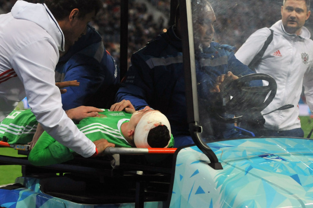 Russia's goalkeeper Andrey Lunev is transported off the field after being injured during an international friendly football match between Russia and Spain at the Saint Petersburg Stadium in Saint Petersburg on November 14, 2017. / AFP PHOTO / OLGA MALTSEVA