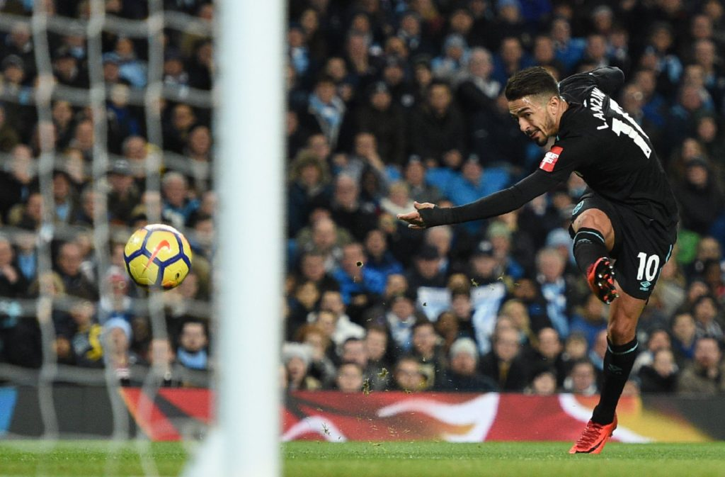 West Ham United's Argentinian midfielder Manuel Lanzini (R) shoots but is saved by Manchester City's Brazilian goalkeeper Ederson  during the English Premier League football match between Manchester City and West Ham United at the Etihad Stadium in Manchester, north west England, on December 3, 2017. / AFP PHOTO / Oli SCARFF / RESTRICTED TO EDITORIAL USE. No use with unauthorized audio, video, data, fixture lists, club/league logos or 'live' services. Online in-match use limited to 75 images, no video emulation. No use in betting, games or single club/league/player publications.  /