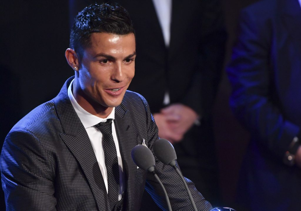 Real Madrid and Portugal forward Cristiano Ronaldo speaks after winning The Best FIFA Men's Player of 2017 Award during The Best FIFA Football Awards ceremony, on October 23, 2017 in London. / AFP PHOTO / Ben STANSALL