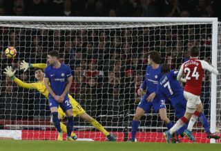 Arsenal's Spanish defender Hector Bellerin (R) shoots and scores past Chelsea's Belgian goalkeeper Thibaut Courtois during the English Premier League football match between Arsenal and Chelsea at the Emirates Stadium in London on January 3, 2018.  / AFP PHOTO / Ian KINGTON / RESTRICTED TO EDITORIAL USE. No use with unauthorized audio, video, data, fixture lists, club/league logos or 'live' services. Online in-match use limited to 75 images, no video emulation. No use in betting, games or single club/league/player publications.  /