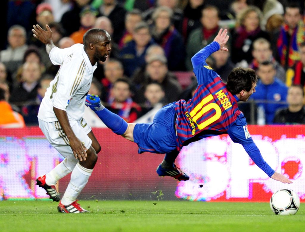 """Barcelona's Argentinian forward Lionel Messi (R) vies with Real Madrid's French midfielder Lassana Diarra (L) during the second leg of the Spanish Cup quarter-final """"El clasico"""" football match Barcelona vs Real Madrid at the Camp Nou stadium in Barcelona on January 25, 2012. Barcelona survived a late comeback from holders Real Madrid to knock them out of the Spanish Cup with a 4-3 victory on aggregate after a 2-2 draw at the Nou Camp where the visitors put up a spirited fightback to come from two goals down. AFP PHOTO/JAVIER SORIANO / AFP PHOTO / JAVIER SORIANO"""