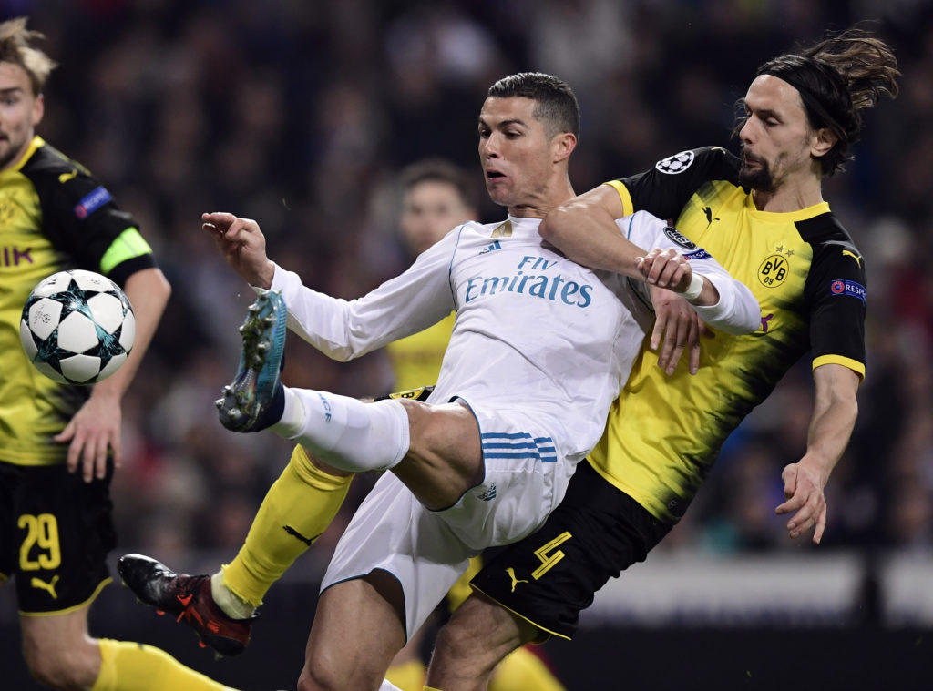 Dortmund's Serbian defender Neven Subotic (R) vies with Real Madrid's Portuguese forward Cristiano Ronaldo during the UEFA Champions League group H football match Real Madrid CF vs Borussia Dortmund at the Santiago Bernabeu stadium in Madrid on December 6, 2017. / AFP PHOTO / JAVIER SORIANO