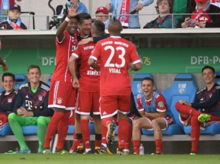 Munich's Franck Ribéry (2-R, standing) celebrates with his teammates on the pitch as well as those on the substitutes' bench after giving his side a 4:0 lead during the German Soccer Association (DFB) Cup first-round soccer match between Chemnitzer FC and FC Bayern Munich in the Community4you Arena in Chemnitz, Germany, 12 August 2017.