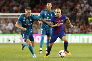 Andres Iniesta and Toni Kroos during the spanish Super Cup match between F.C. Barcelona v Real Madrid, in Barcelona, on August 13, 2017. (Photo by Urbanandsport/NurPhoto)