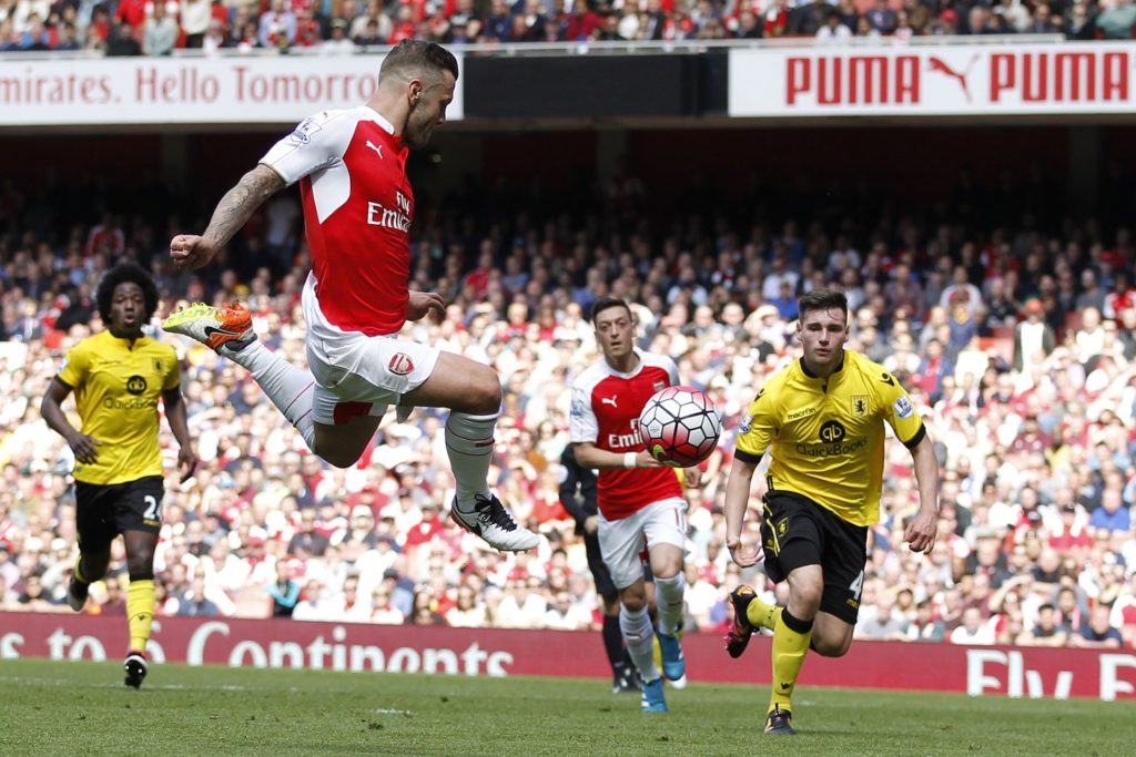 Arsenal's English midfielder Jack Wilshere (2L) jumps to shoot, but misses, during the English Premier League football match between Arsenal and Aston Villa at the Emirates Stadium in London on May 15, 2016.  / AFP PHOTO / Ian Kington / RESTRICTED TO EDITORIAL USE. No use with unauthorized audio, video, data, fixture lists, club/league logos or 'live' services. Online in-match use limited to 75 images, no video emulation. No use in betting, games or single club/league/player publications.  /