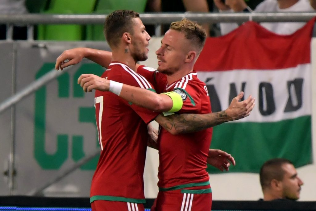 Hungary's midfielder Balazs Dzsudzsak (R) and Roland Varga (L) celebrate their third goal during the FIFA World Cup 2018 qualification football match between Hungary and Latvia in Budapest on August 31, 2017.  / AFP PHOTO / ATTILA KISBENEDEK