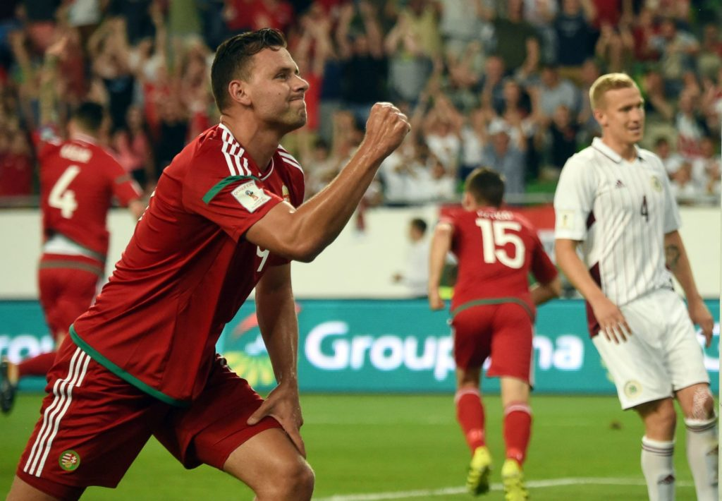 Hungary's Adam Szalai (L) celebrates a goal during the FIFA World Cup 2018 qualification football match between Hungary and Latvia in Budapest on August 31, 2017.  / AFP PHOTO / ATTILA KISBENEDEK