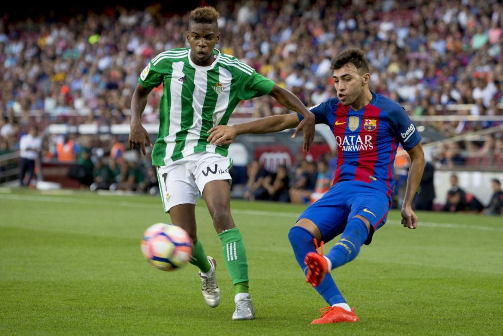 BARCELONA, SPAIN -  AUGUST 20: FC Barcelona's player Munir El Haddadi (R) in action during the Spanish La Liga soccer match between FC Barcelona and Real Betis at Camp Nou Stadium on August 20, 2016 in Barcelona, Spain. Albert Llop / Anadolu Agency