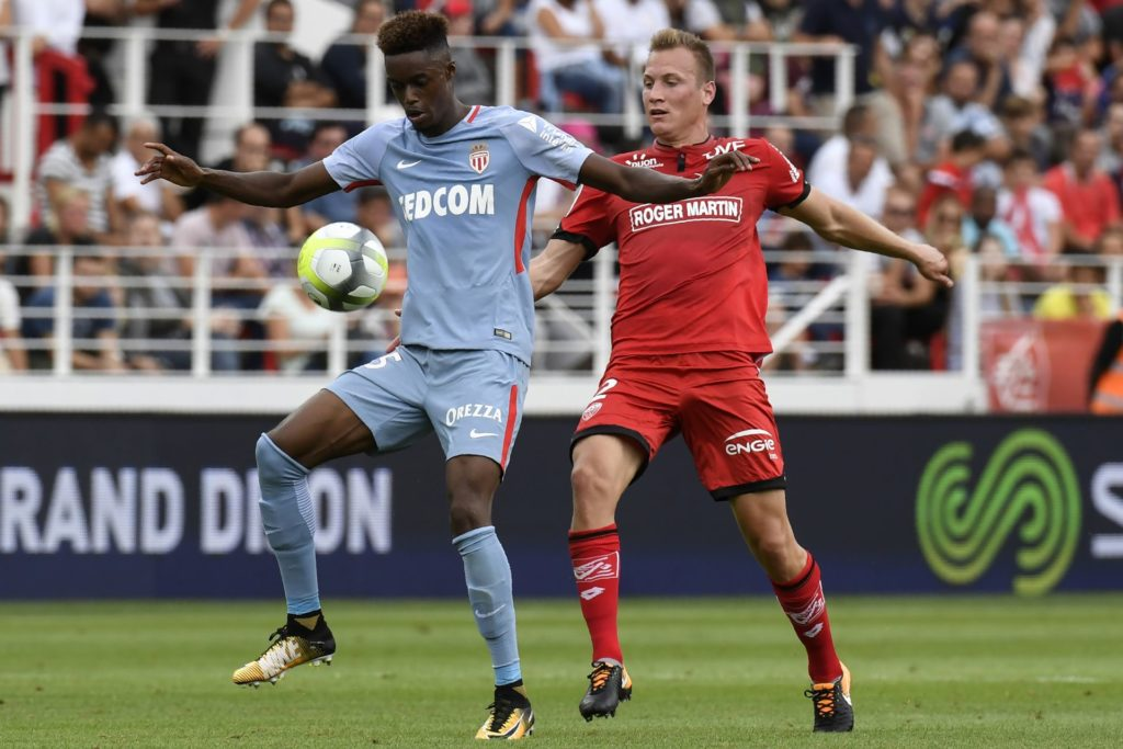 Monaco's French forward Adama Diakhaby (L) vies with Dijon's Hungarian defender Adam Lang (R) during the French L1 football match between Dijon FCO and AS Monaco, on August 13, 2017 at Gaston Gerard stadium in Dijon, northern France. / AFP PHOTO / PHILIPPE DESMAZES