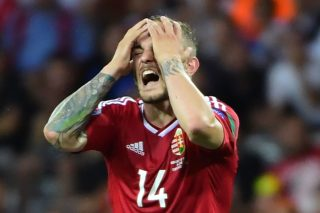 Hungary's forward Gergo Lovrencsics reacts after missing a goal opportunity  during the Euro 2016 round of 16 football match between Hungary and Belgium at the Stadium Municipal in Toulouse on June 26, 2016.   / AFP PHOTO / EMMANUEL DUNAND
