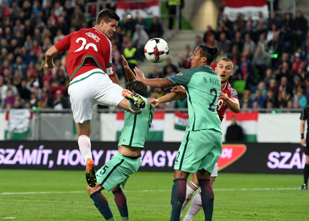 Hungary's Richard Guzmics (L) vies with Portugal's Fabio Coentrao during the FIFA World Cup 2018 qualification football match between Hungary and Portugal in Budapest on September 3, 2017. / AFP PHOTO / ATTILA KISBENEDEK