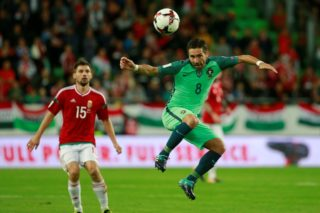 BUDAPEST, HUNGARY - SEPTEMBER 3: Portugal's Joao Moutinho (8) in action against Hungary's Mate Patkai (15)  during the FIFA World Cup 2018 qualification football match between Hungary and Portugal at the Grupama Arena in Budapest on September 3, 2017.  Arpad Kurucz / Anadolu Agency