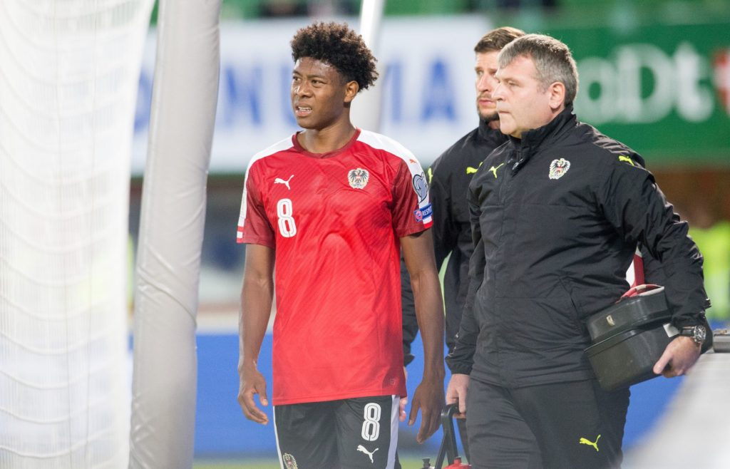 Austria's defender David Alaba walks off injured during the Group D FIFA World Cup 2018 qualification match between Austria and Georgia at the Ernst Happel Stadium in Vienna on September 5, 2017. / AFP PHOTO / APA / GEORG HOCHMUTH / Austria OUT