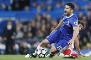 Middlesbrough's Brazilian defender Fabio (R) tackles Chelsea's Brazilian-born Spanish striker Diego Costa during the English Premier League football match between Chelsea and Middlesbrough at Stamford Bridge in London on May 8, 2017. / AFP PHOTO / Adrian DENNIS / RESTRICTED TO EDITORIAL USE. No use with unauthorized audio, video, data, fixture lists, club/league logos or 'live' services. Online in-match use limited to 75 images, no video emulation. No use in betting, games or single club/league/player publications.  /
