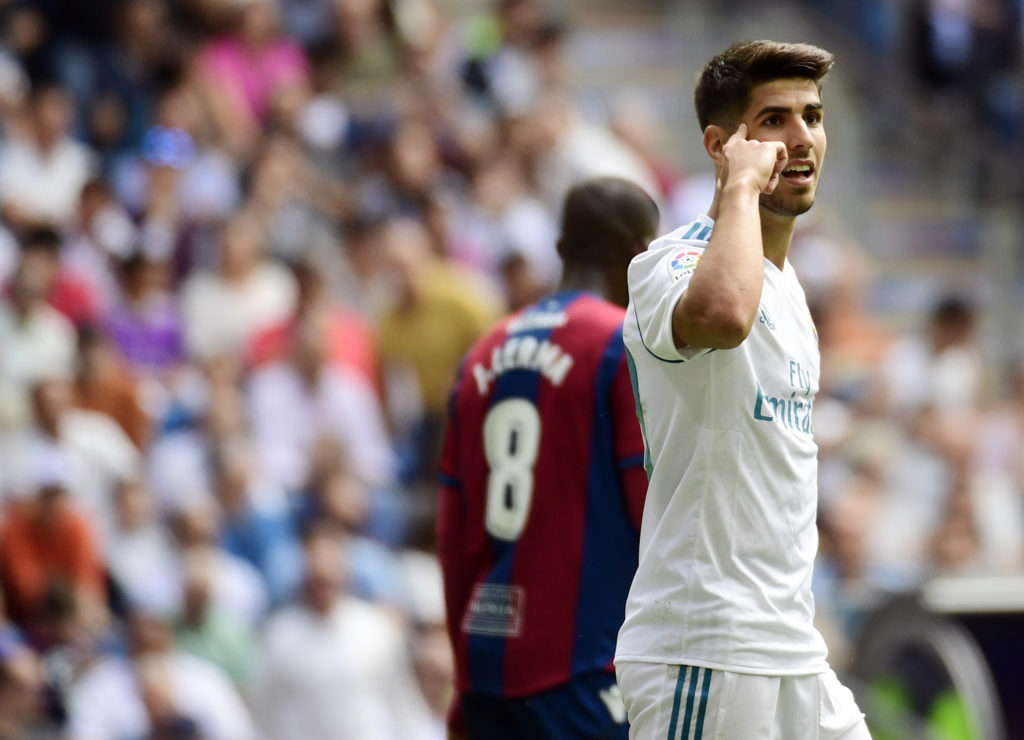 Real Madrid's midfielder Marco Asensio gestures during the Spanish Liga football match Real Madrid vs Levante at the Santiago Bernabeu stadium in Madrid on September 9, 2017. / AFP PHOTO / PIERRE-PHILIPPE MARCOU