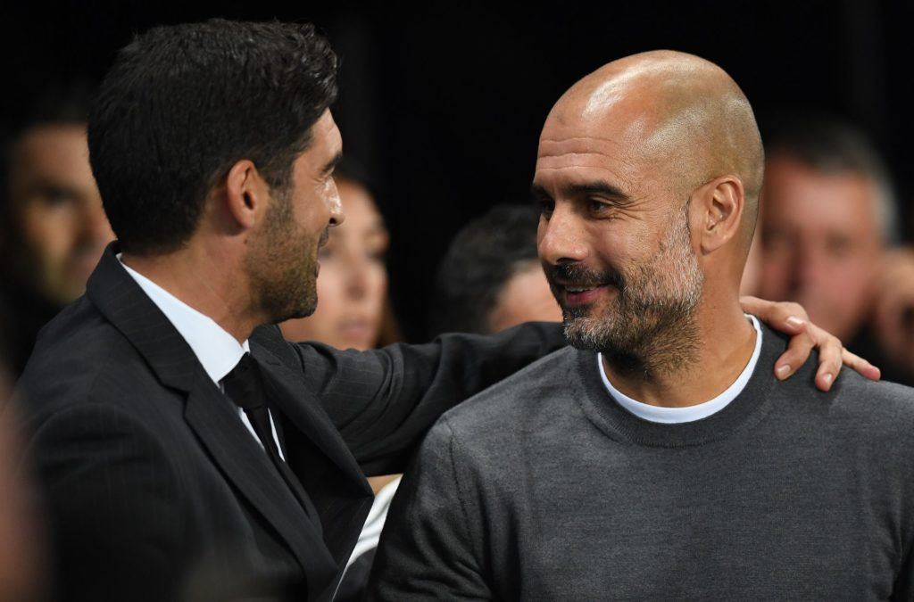 Manchester City's Spanish manager Pep Guardiola (R) greets Shakhtar Donetsk's Portuguese manager Paulo Fonseca ahead of the Group F football match between Manchester City and Shakhtar Donetsk at the Etihad Stadium in Manchester, north west England, on September 26, 2017. / AFP PHOTO / Paul ELLIS