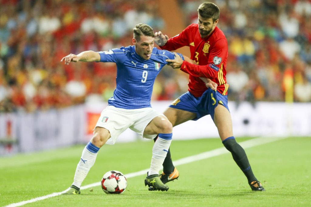 MADRID, SPAIN - SEPTEMBER 2: Andrea Belotti (L) of Italy in action against Gerard Piqué (R) of Italy during the 2018 FIFA World Cup Qualifications Group G match between Spain and Italy at the Santiago Bernabeu Stadium in Madrid, Spain on September 2, 2017. Juan Carlos Rojas / Anadolu Agency