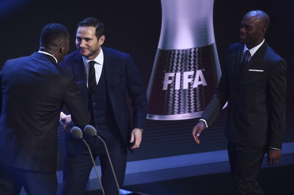 England's former player Frank Lampard (2nd L) shakes hands with British actor Idris Elba as he come on to present the FIFA FIFPro World11 award 2017, on stage during The Best FIFA Football Awards ceremony, on October 23, 2017 in London. / AFP PHOTO / Ben STANSALL