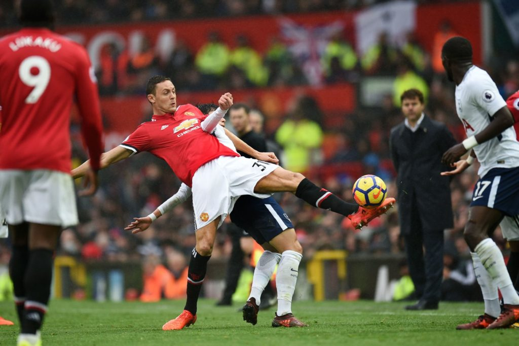 Manchester United's Serbian midfielder Nemanja Matic vies with Tottenham Hotspur's South Korean striker Son Heung-Min during the English Premier League football match between Manchester United and Tottenham Hotspur at Old Trafford in Manchester, north west England, on October 28, 2017. / AFP PHOTO / Oli SCARFF / RESTRICTED TO EDITORIAL USE. No use with unauthorized audio, video, data, fixture lists, club/league logos or 'live' services. Online in-match use limited to 75 images, no video emulation. No use in betting, games or single club/league/player publications.  /