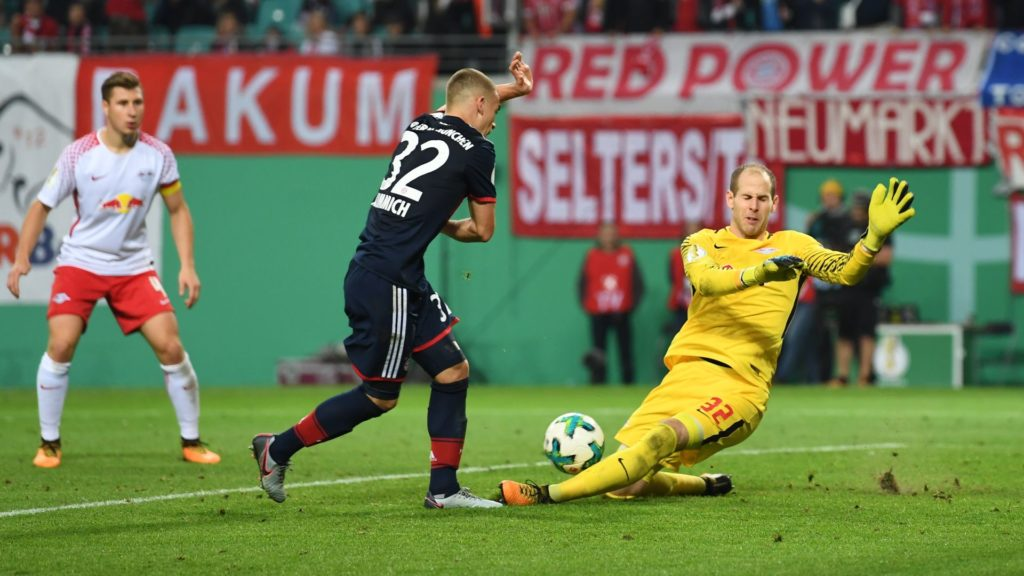 Munich's David Alaba and Leipzig's keeper Peter Gulacsi vie for the ball during the DFB Cup soccer match between RB Leipzig and Bayern Munich in Leipzig, Germany, 25 October 2017. Photo: Hendrik Schmidt/dpa-Zentralbild/dpa