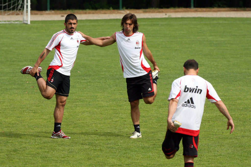 CARNAGO, ITALY - MAY 16: Gennaro Gattuso (L), Andrea Pirlo and Cristian Brocchi stretch during a training session ahead of next week's UEFA Champions League Final against Liverpool during the AC Milan Media Day at Milanello on May 16, 2007 in Carnago, Italy.  (Photo Giuseppe Cacace/Getty Images)