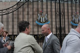 UK, Newcastle upon Tyne: Newcastle United fans meet and pose for pictures with football legend Alan Sheerer after a statue of him is unveiled outside of St. James' Park in Newcastle upon Tyne on September 12, 2016. The 9-foot-6-inch sculpture, named Local Hero, depicts Shearer's famous one-hand-in-the-air goal celebration. It has been ten years since Shearer retired. - David Whinham
