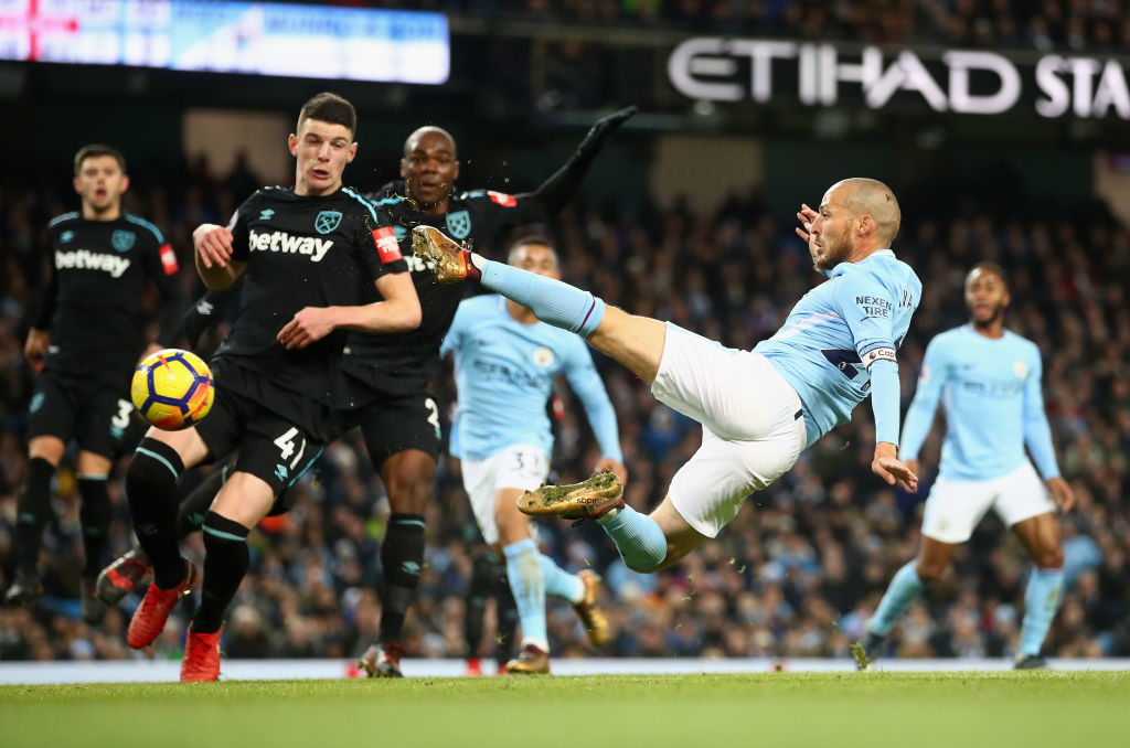 MANCHESTER, ENGLAND - DECEMBER 03:  David Silva of Manchester City scores his sides second goal during the Premier League match between Manchester City and West Ham United at Etihad Stadium on December 3, 2017 in Manchester, England.  (Photo by Clive Brunskill/Getty Images)