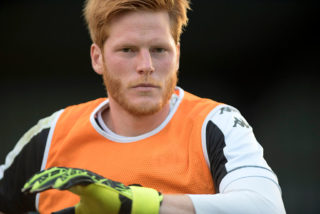 MACCLESFIELD, ENGLAND - JULY 20: Adam Bogdan warming up prior to the Pre-Season Friendly between Macclesfield Town and Wigan Athletic at Moss Rose Ground on July 20, 2016 in Macclesfield, England. (Photo by Nathan Stirk/Getty Images)