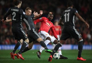 3250631 12/05/2017 CSKA's Mario Fernandes, Vasily Berezutsky, Manchester's Paul Pogba, CSKA's Vitinho, left to right, during a group stage match of the UEFA Champions League between Manchester United (Manchester, England) and CSKA (Moscow, Russia). Alexey Filippov/Sputnik