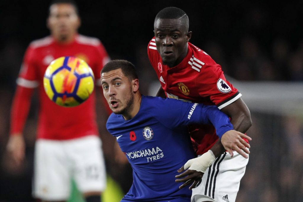 Manchester United's Ivorian defender Eric Bailly (R) vies with Chelsea's Belgian midfielder Eden Hazard during the English Premier League football match between Chelsea and Manchester United at Stamford Bridge in London on November 5, 2017. / AFP PHOTO / Adrian DENNIS / RESTRICTED TO EDITORIAL USE. No use with unauthorized audio, video, data, fixture lists, club/league logos or 'live' services. Online in-match use limited to 75 images, no video emulation. No use in betting, games or single club/league/player publications.  /