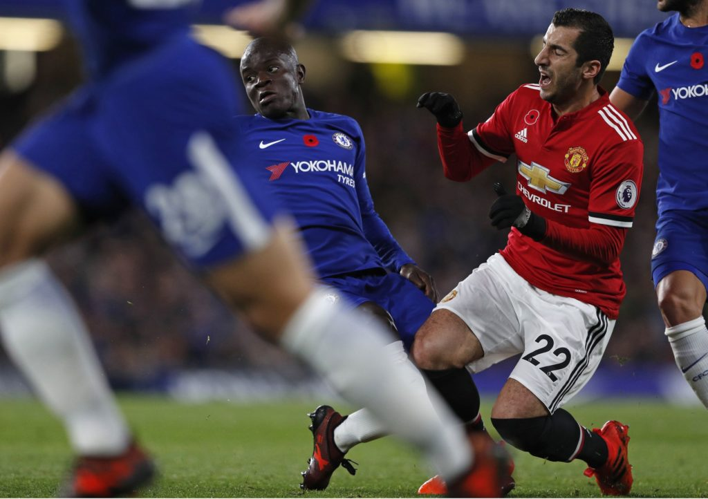 Chelsea's French midfielder Tiemoue Bakayoko (L) fouls Manchester United's Armenian midfielder Henrikh Mkhitaryan during the English Premier League football match between Chelsea and Manchester United at Stamford Bridge in London on November 5, 2017. / AFP PHOTO / Adrian DENNIS / RESTRICTED TO EDITORIAL USE. No use with unauthorized audio, video, data, fixture lists, club/league logos or 'live' services. Online in-match use limited to 75 images, no video emulation. No use in betting, games or single club/league/player publications.  /