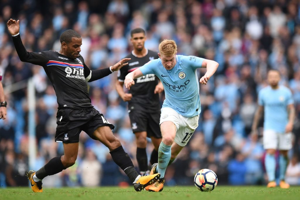 Crystal Palace's English midfielder Jason Puncheon (L) tackles Manchester City's Belgian midfielder Kevin De Bruyne during the English Premier League football match between Manchester City and Crystal Palace at the Etihad Stadium in Manchester, north west England, on September 23, 2017. / AFP PHOTO / Oli SCARFF / RESTRICTED TO EDITORIAL USE. No use with unauthorized audio, video, data, fixture lists, club/league logos or 'live' services. Online in-match use limited to 75 images, no video emulation. No use in betting, games or single club/league/player publications.  /