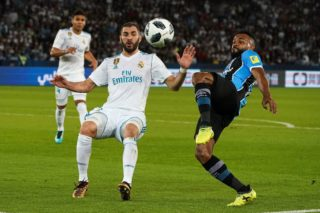 ABU DHABI, UAE - DECEMBER 16: Karim Benzema (L) of Real Madrid in action against Fernandinho (R) of Gremio during the 2017 FIFA Club World Cup final match between Real Madrid and Gremio at Zayed Sports City Stadium in Abu Dhabi, United Arab Emirates on December 16, 2017.  Stringer / Anadolu Agency