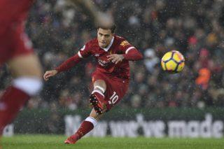 Liverpool's Brazilian midfielder Philippe Coutinho takes a free kick that is saved during the English Premier League football match between Liverpool and Everton at Anfield in Liverpool, north west England on December 10, 2017.  / AFP PHOTO / Paul ELLIS / RESTRICTED TO EDITORIAL USE. No use with unauthorized audio, video, data, fixture lists, club/league logos or 'live' services. Online in-match use limited to 75 images, no video emulation. No use in betting, games or single club/league/player publications.  /