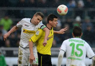 Dortmund's striker Balint Bajner (R) and Moenchengladbach's Belgian defender Filip Daems vie for the ball during the German first division Bundesliga football match Borussia Moenchengladbach vs Borussia Dortmund in the German city of Moenchengladbach on February 24, 2013. AFP PHOTO / PATRIK STOLLARZ  DFL RULES TO LIMIT THE ONLINE USAGE DURING MATCH TIME TO 15 PICTURES PER MATCH. IMAGE SEQUENCES TO SIMULATE VIDEO IS NOT ALLOWED AT ANY TIME. FOR FURTHER QUERIES PLEASE CONTACT DFL DIRECTLY AT + 49 69 650050. / AFP PHOTO / PATRIK STOLLARZ