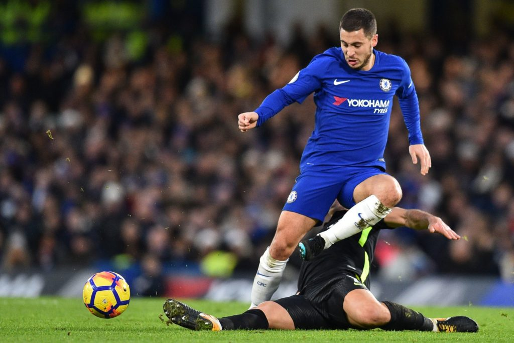 Chelsea's Belgian midfielder Eden Hazard is tackled by Brighton's Israeli midfielder Beram Kayal during the English Premier League football match between Chelsea and Brighton and Hove Albion at Stamford Bridge in London on December 26, 2017. / AFP PHOTO / Glyn KIRK / RESTRICTED TO EDITORIAL USE. No use with unauthorized audio, video, data, fixture lists, club/league logos or 'live' services. Online in-match use limited to 75 images, no video emulation. No use in betting, games or single club/league/player publications.  /