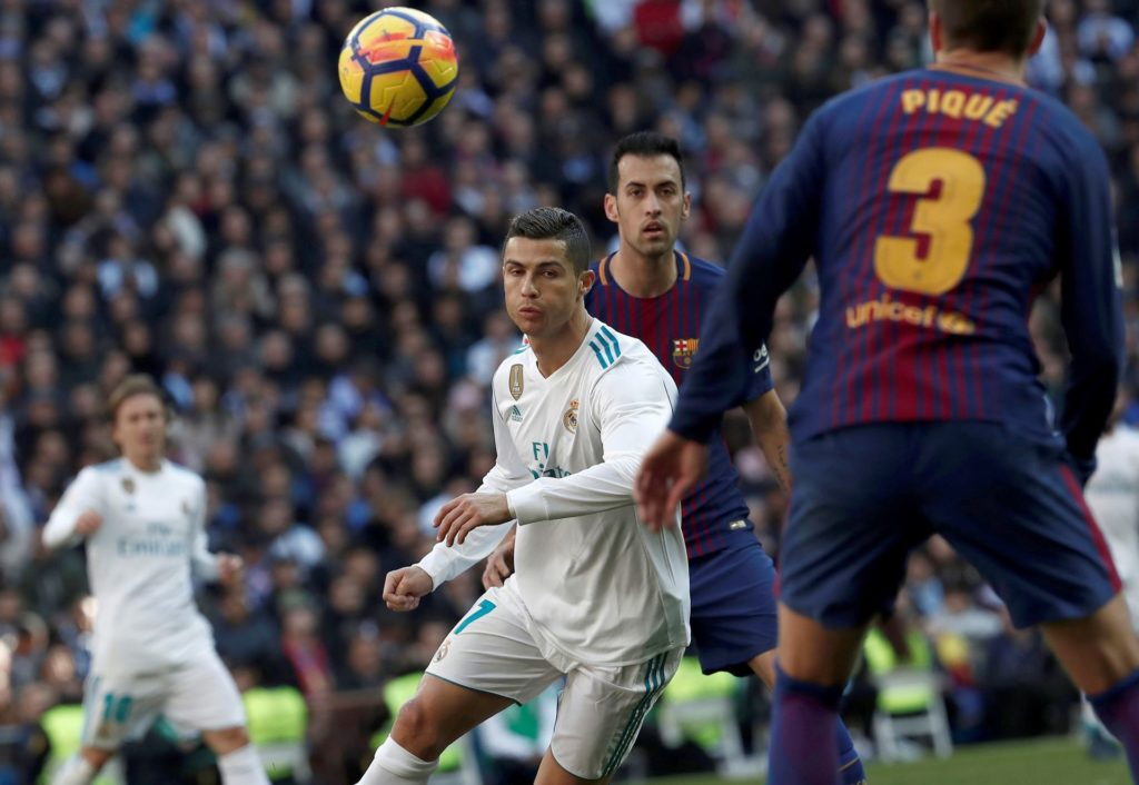 MADRID, SPAIN - DECEMBER 23: Cristiano Ronaldo (2nd L) of Real Madrid in action against Sergio Busquets (2nd R) and Gerard Pique (R) of Barcelona during the La Liga match between Real Madrid and Barcelona at Santiago Bernabeu Stadium in Madrid, Spain on December 23, 2017. Burak Akbulut / Anadolu Agency